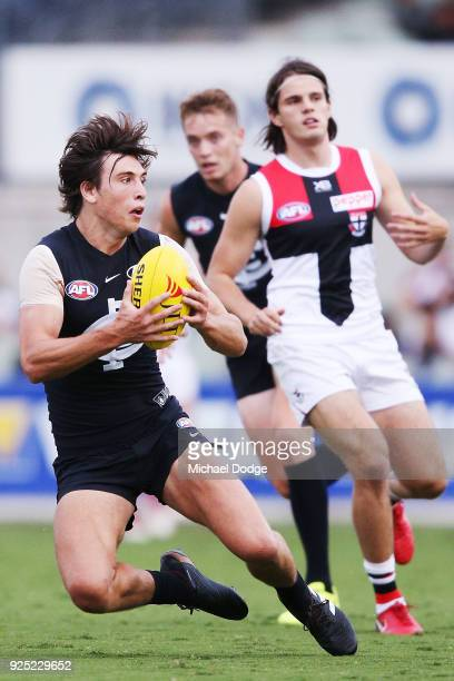 Caleb Marchbank of the Blues marks the ball during the JLT Community Series AFL match between the Carlton Blues and the St Kilda Saints at Ikon Park...