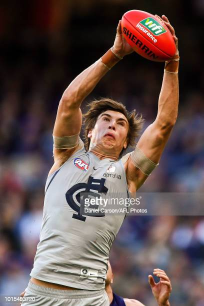 Caleb Marchbank of the Blues takes a mark during the 2018 AFL round 21 match between the Fremantle Dockers and the Carlton Blues at Optus Stadium on...