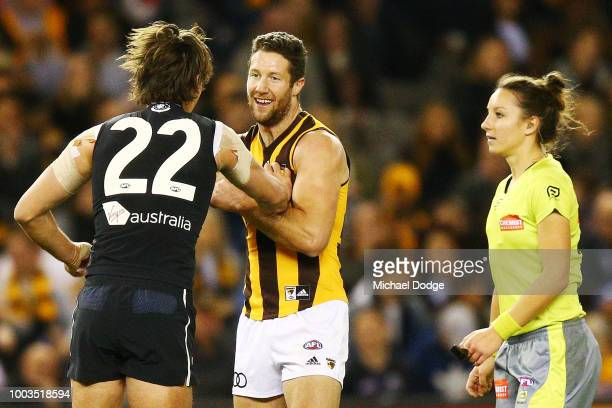 Caleb Marchbank of the Blues wrestles with James Frawley of the Hawks during the round 18 AFL match between the Carlton Blues and the Hawthorn Hawks...