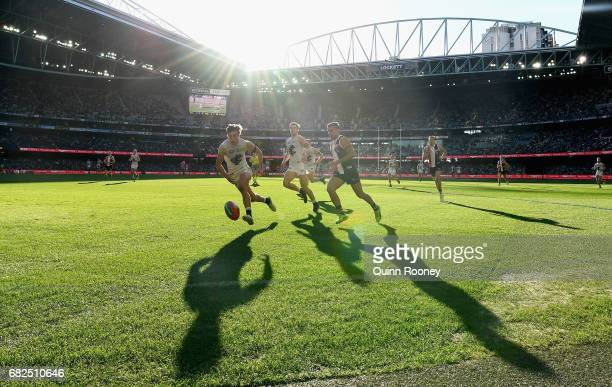 Caleb Marchbank of the Bluesand Darren Minchington of the Saints compete for the ball during the round eight AFL match between the St Kilda Saints...