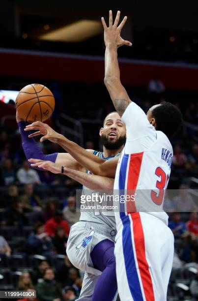 Caleb Martin of the Charlotte Hornets goes to the basket against John Henson of the Detroit Pistons during the first half at Little Caesars Arena on...