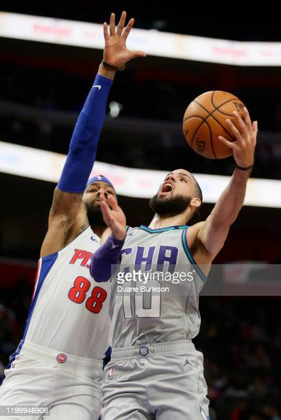 Caleb Martin of the Charlotte Hornets goes to the basket against Markieff Morris of the Detroit Pistons during the first half at Little Caesars Arena...