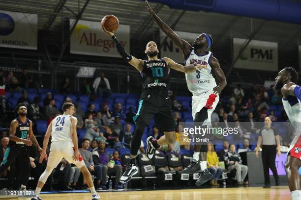 Caleb Martin of the Greensboro Swarm shoots against Ismael Sanogo of the Long Island Nets at The Fieldhouse in Greensboro, North Carolina. NOTE TO...