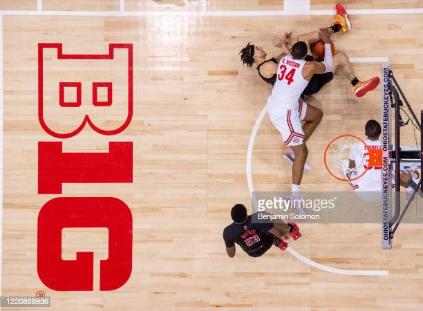 Caleb McConnell of the Rutgers Scarlet Knights and Kaleb Wesson of the Ohio State Buckeyes fight for the ball at Value City Arena on February 12,...