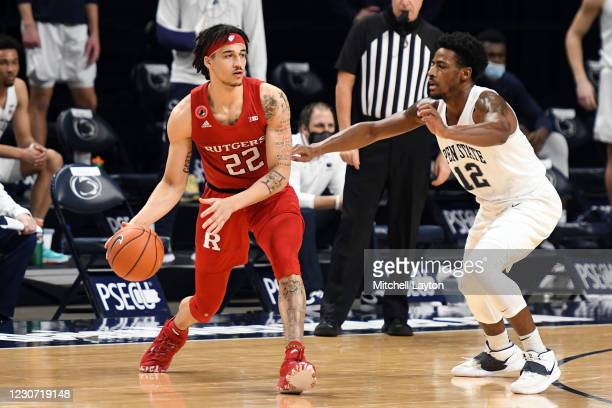 Caleb McConnell of the Rutgers Scarlet Knights dribbles around Izaiah Brockington of the Penn State Nittany Lions in the first half during a college...