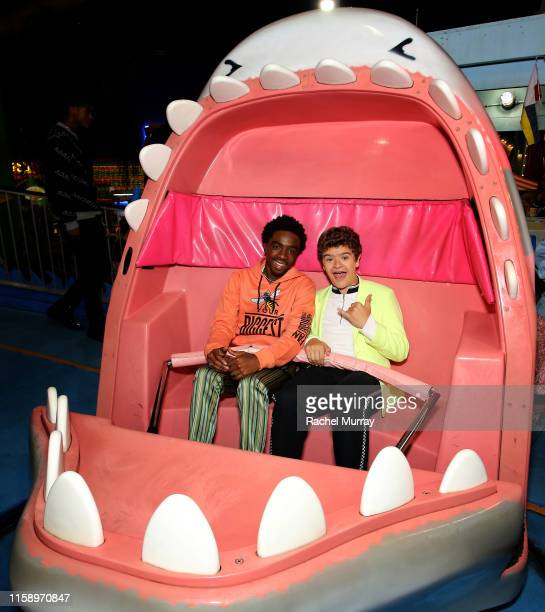 Caleb McLaughlin and Gaten Matarazzo attend the Stranger Things Season 3 World Premiere on June 28 2019 in Santa Monica California