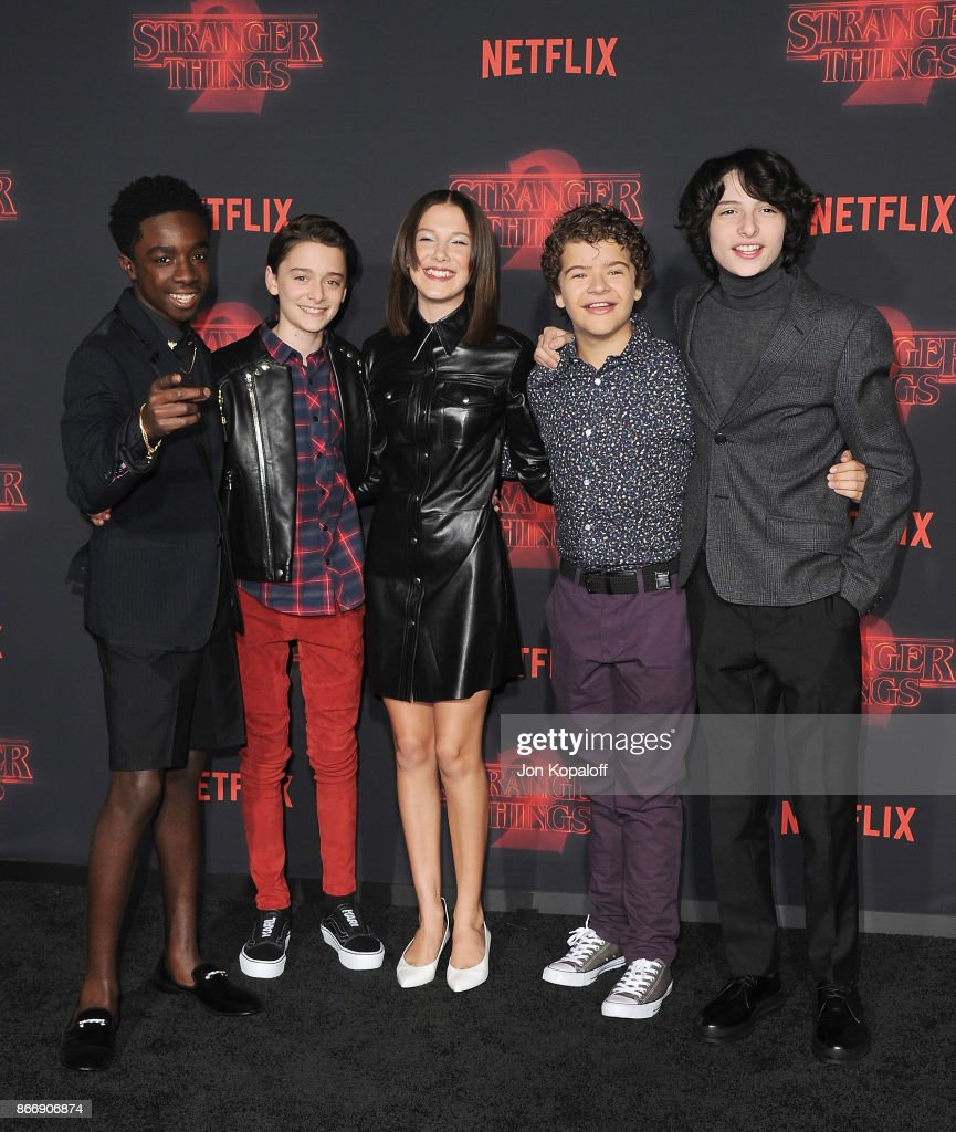 Caleb McLaughlin, Noah Schnapp, Millie Bobby Brown, Gaten Matarazzo, and Finn Wolfhard arrive at the premiere of Netflix's 'Stranger Things' Season 2 at Regency Bruin Theatre on October 26, 2017 in Los Angeles, California.
