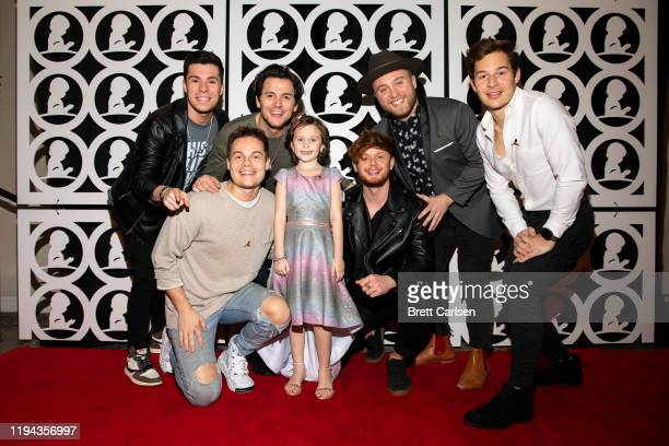 Caleb Miller Chris Deaton Simon Dumas Jordan Harvey Chad Michael Jervis and Austin Luther of King Calaway pose with St Jude patient Londyn during...