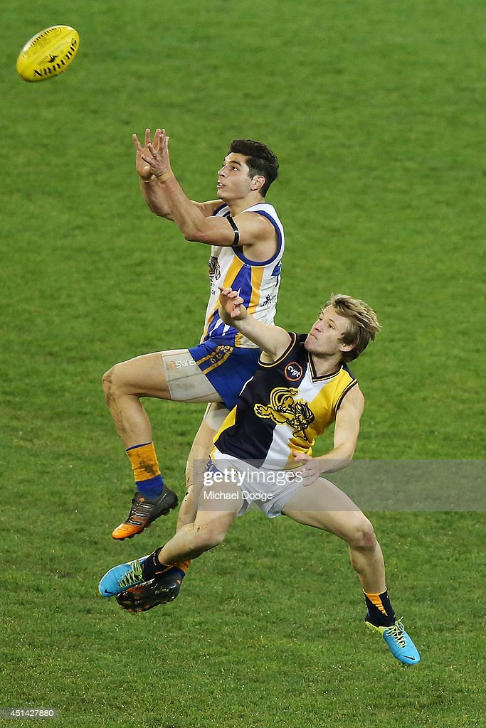 Caleb Raiti of Box Hill marks the ball over Wade Minter of Bendigo during the AFL Secondary Schools Grand Final between Bendigo SSC V Box Hill SSC at Melbourne Cricket Ground on June 29, 2014 in Melbourne, Australia.
