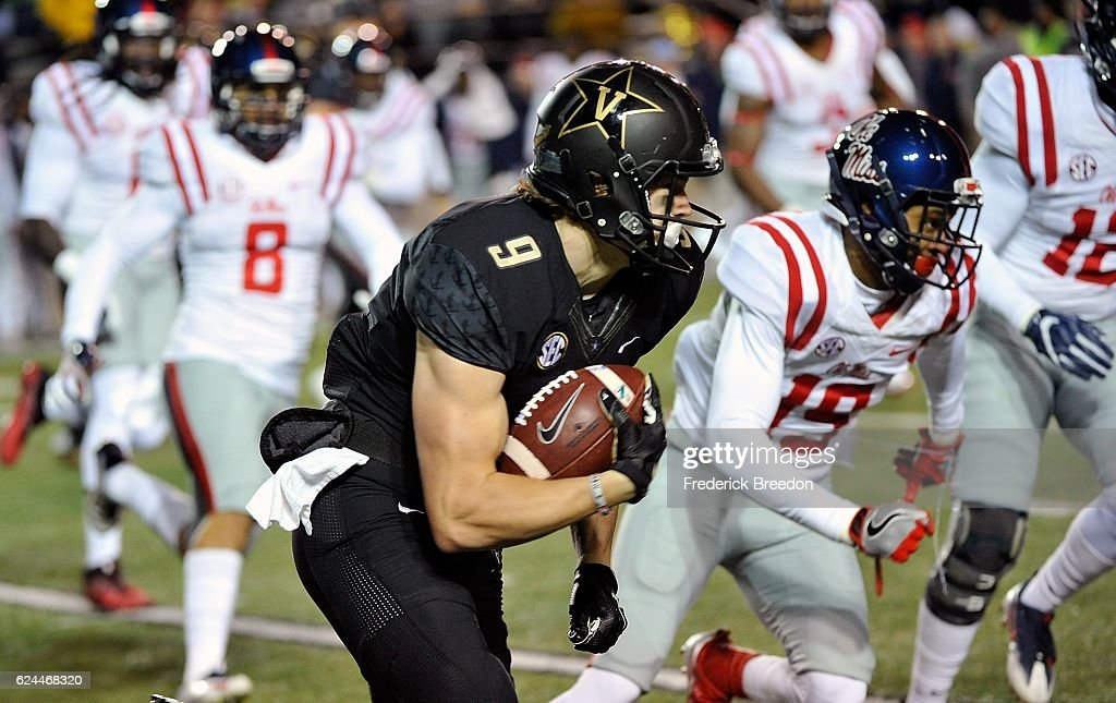 Caleb Scott #9 of the Vanderbilt Commodores carries the ball after making a catch against Derrick Jones #19 of the Ole Miss Rebels during the first half at Vanderbilt Stadium on November 19, 2016 in Nashville, Tennessee.