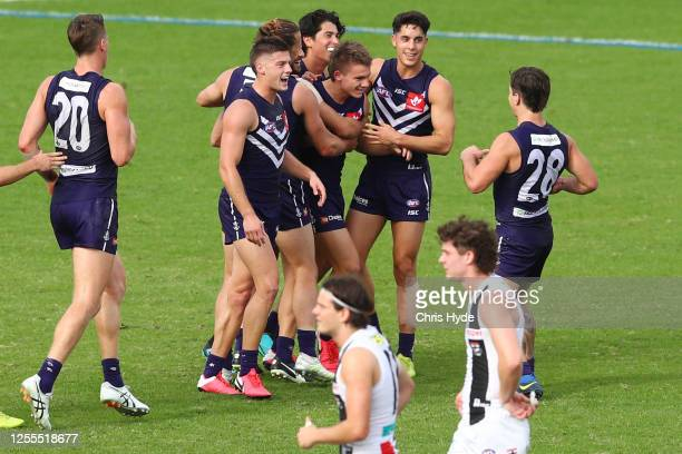 Caleb Serong of the Dockers celebrates a goal during the round 6 AFL match between the Fremantle Dockers and the St Kilda Saints at Metricon Stadium...