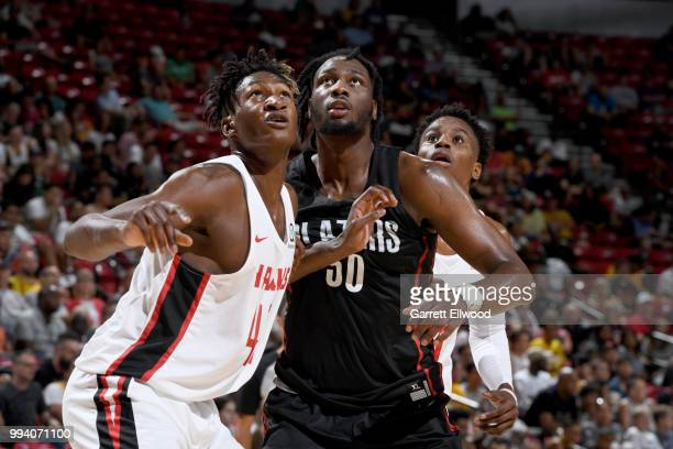 Caleb Swanigan of the Portland Trail Blazers battles for position against Alpha Kaba of the Atlanta Hawks during the 2018 Las Vegas Summer League on...