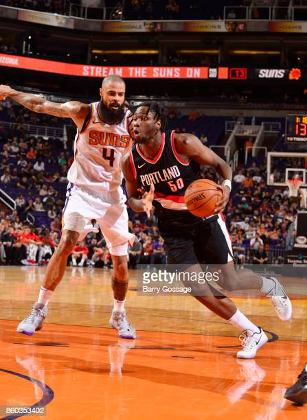Caleb Swanigan of the Portland Trail Blazers handles the ball against Tyson Chandler of the Phoenix Suns during the preseason game on October 11 2017...