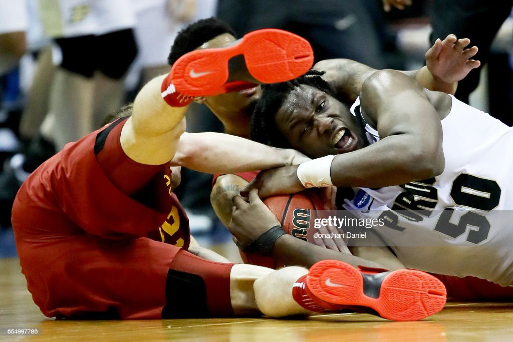 Caleb Swanigan #50 of the Purdue Boilbermakers battles for a loose ball against Matt Thomas #21 and Darrell Bowie #10 of the Iowa State Cyclones in the second half during the second round of the 2017 NCAA Tournament at BMO Harris Bradley Center on March 18, 2017 in Milwaukee, Wisconsin.