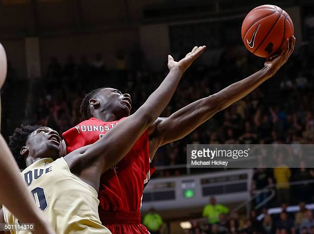 Caleb Swanigan of the Purdue Boilermakers and Sidney Umude of the Youngstown State Penguins reach for the rebound at Mackey Arena on December 12 2015...