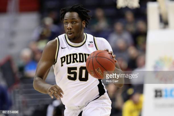 Caleb Swanigan of the Purdue Boilermakers dribbles the ball against the Michigan Wolverines during the Big Ten Basketball Tournament at Verizon...