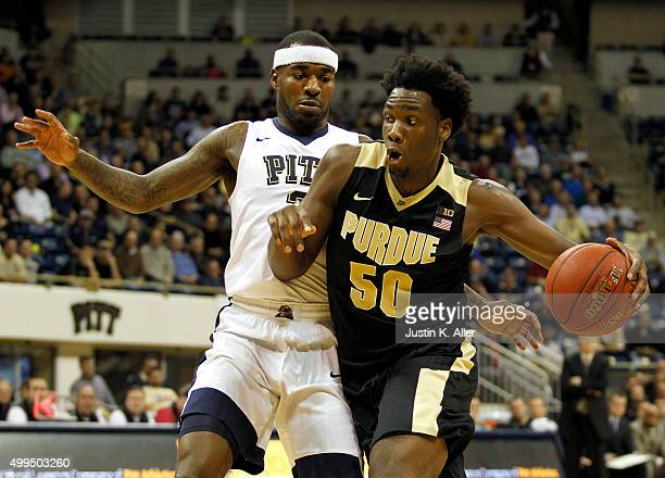 Caleb Swanigan of the Purdue Boilermakers drives to the hole against Michael Young of the Pittsburgh Panthers during the game at Petersen Events...