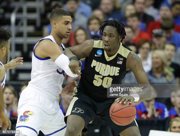 Caleb Swanigan of the Purdue Boilermakers is defended by Landen Lucas of the Kansas Jayhawks during the 2017 NCAA Men's Basketball Tournament Midwest...