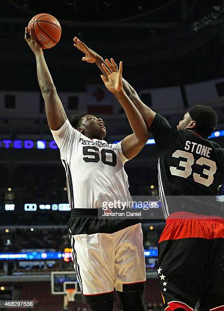 Caleb Swanigan shoots over Diamond Stone of the East team during the 2015 McDonalds's All American Game at the United Center on April 1 2015 in...