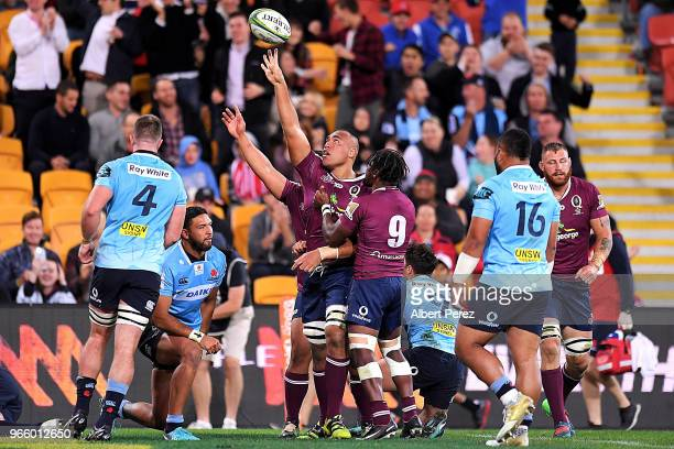 Caleb Timu of the Reds celebrates with team mates after scoring a try during the round 16 Super Rugby match between the Reds and the Waratahs at...
