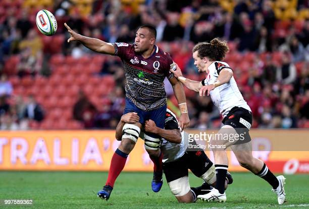 Caleb Timu of the Reds offloads during the round 19 Super Rugby match between the Reds and the Sunwolves at Suncorp Stadium on July 13 2018 in...