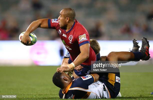 Caleb Timu of the Reds offloads during the round 8 Super Rugby match between the Brumbies and the Reds at University of Canberra Oval on April 7 2018...
