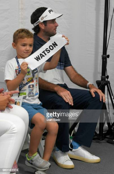 Caleb Watson son of Bubba Watson holds his father's nameplate after final round of the Travelers Championship at TPC River Highlands on June 24 2018...