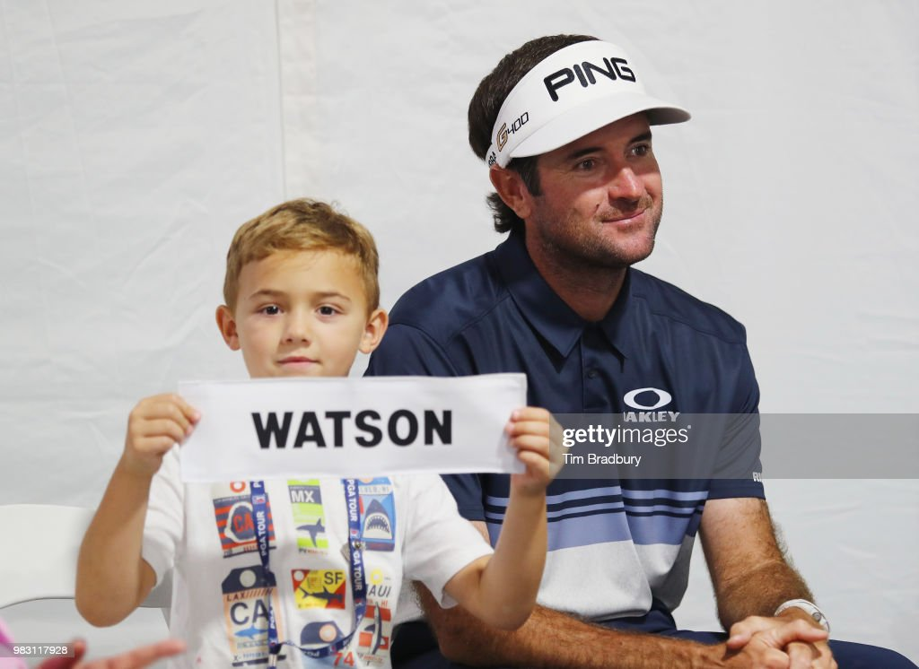 Caleb Watson, son of Bubba Watson of the United States, holds his father's nameplate after the final round of the Travelers Championship at TPC River Highlands on June 24, 2018 in Cromwell, Connecticut.