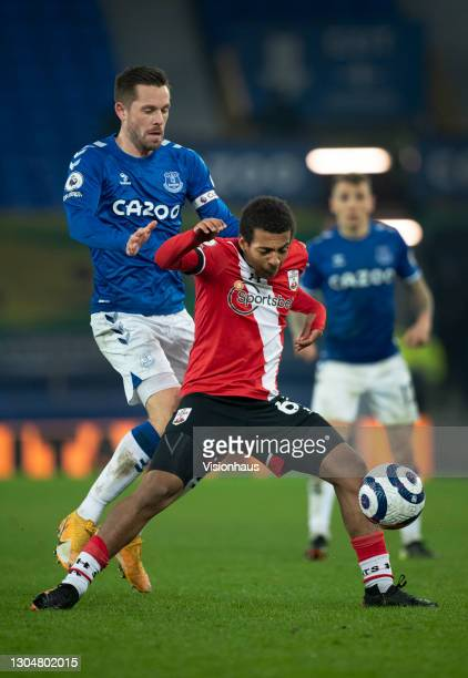 Caleb Watts of Southampton and Gylfi Sigurdsson of Everton in action during the Premier League match between Everton and Southampton at Goodison Park...