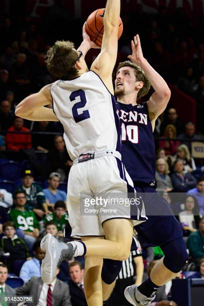 Caleb Wood of the Pennsylvania Quakers drives to the basket against Eric Monroe of the Yale Bulldogs during the second half at The Palestra on...