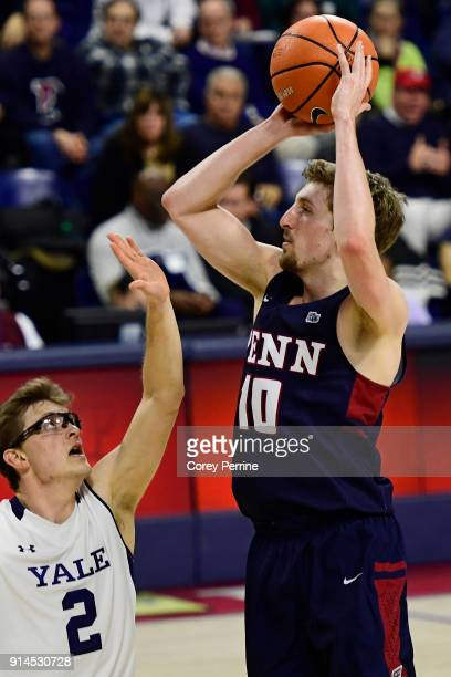 Caleb Wood of the Pennsylvania Quakers shoots the ball past Eric Monroe of the Yale Bulldogs during the second half at The Palestra on February 3...
