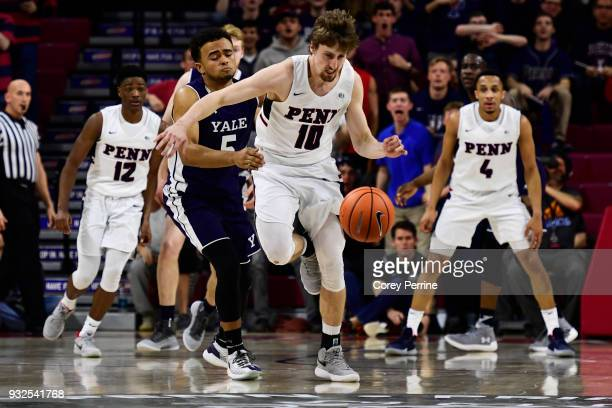 Caleb Wood of the Pennsylvania Quakers steals the ball from Azar Swain of the Yale Bulldogs during the first half of a semifinal round matchup in the...