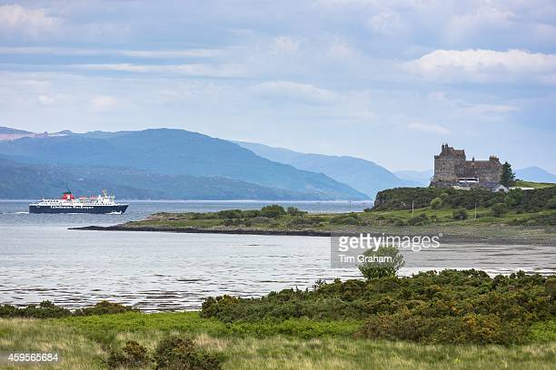 Caledonian Macbrayne - Calmac - ferry on Sound of Mull leaves Craignure past Duart Castle on Isle of Mull in the Inner Hebrides and Western Isles,...