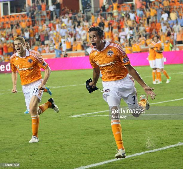 Calen Carr of the Houston Dynamo celebrates with Andre Hainault of the Houston Dynamo after his second half score against the Sporting KC at BBVA...