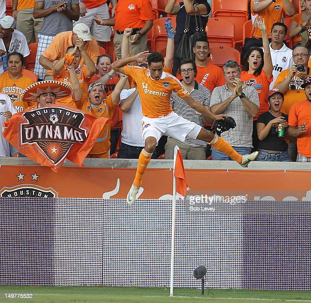 Calen Carr of the Houston Dynamo leaps over the corner flag after scoring against the New York Red Bulls in the first half at BBVA Compass Stadium on...