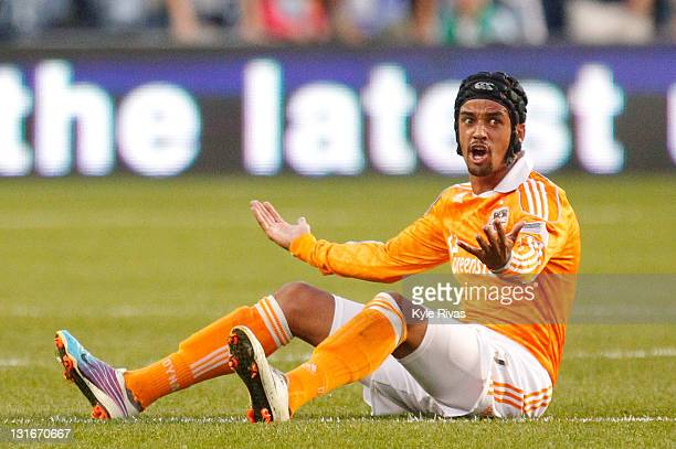 Calen Carr of the Houston Dynamo looks towards the referee after being tripped by Sporting Kansas City in the first half during the MLS Eastern...