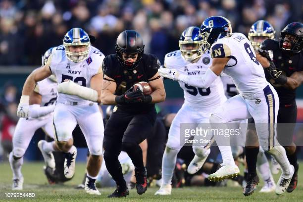 Calen Holt of the Army Black Knights carries the ball during the second quarter of the game against the Navy Midshipmen at Lincoln Financial Field on...