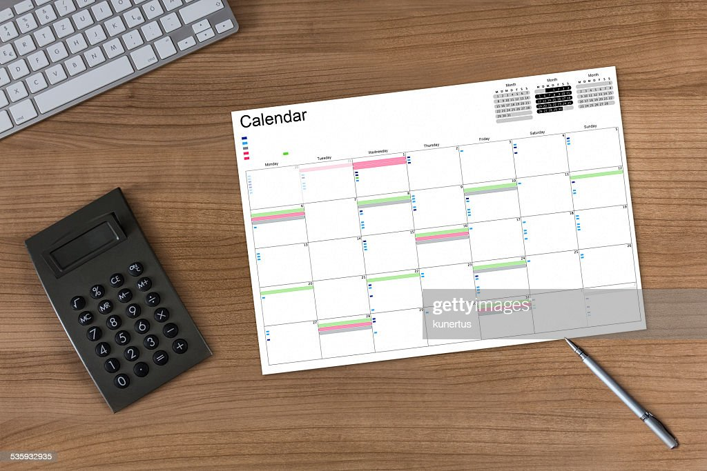Calendar and Calculator on wooden Table : Stock Photo