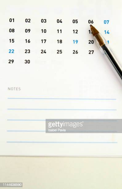 calendar and pen on white table - calendar icon stock photos and pictures