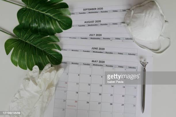 2020 calendar folders and pandemic accessories - julio fotografías e imágenes de stock