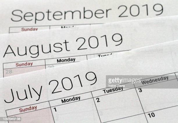 calendar folders - julio fotografías e imágenes de stock