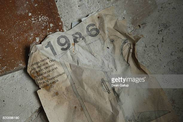 A calendar from the fateful year 1986 lies on the floor of a former hospital on April 9 2016 in Pripyat Ukraine Pripyat built in the 1970s as a model...