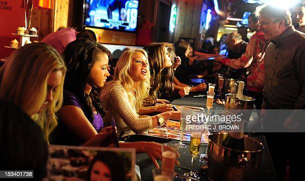 Calendar girls during an autograph session at the 2013 Hooters Calendar release party in Hollywood on October 4, 2012 in California. The American...