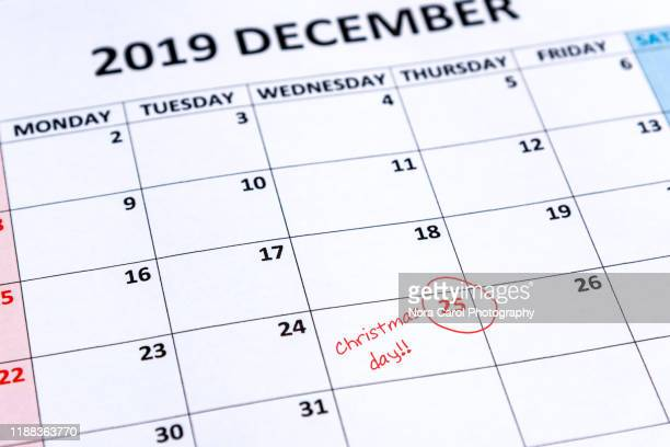 calendar indicating christmas day on 25th - advent calendar stock photos and pictures