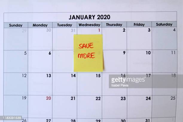 """calendar indicating """"save more"""" on 1st january - 2020 calendar stock photos and pictures"""