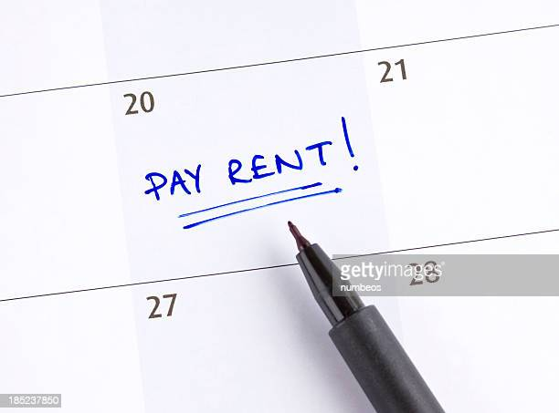 A calendar marked pay rent! on the 20th of the month