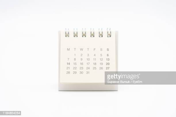calendar on white background - calendar stock pictures, royalty-free photos & images