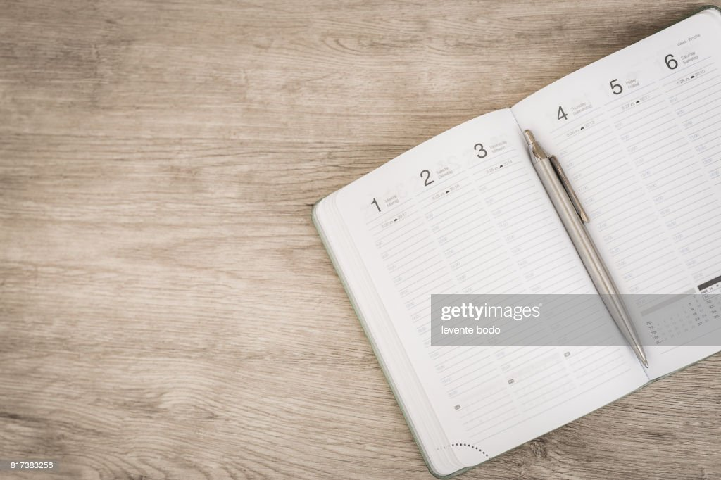 Calendar, smartphone, tablet. Workplace with tablet pc and smartphone on table close-up : Stock Photo