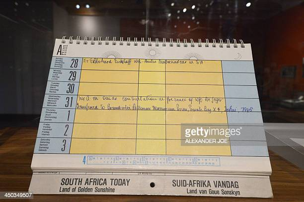 A calendar South Africa's Nelson Mandela had in his prison cell the day he was removed from Robben Island is diplayed on November 18 2013 at the...