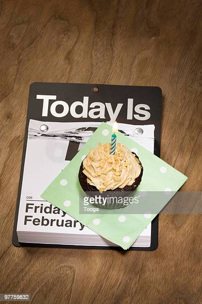 Calendar with cupcake with candle